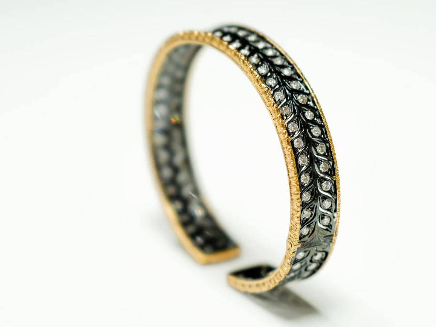 product photography of a black and golden bracelet